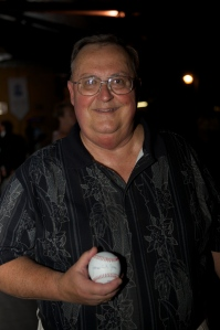 Fred Snyder of WGET Radio holding his signed baseball.